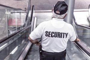 security guard on escalator