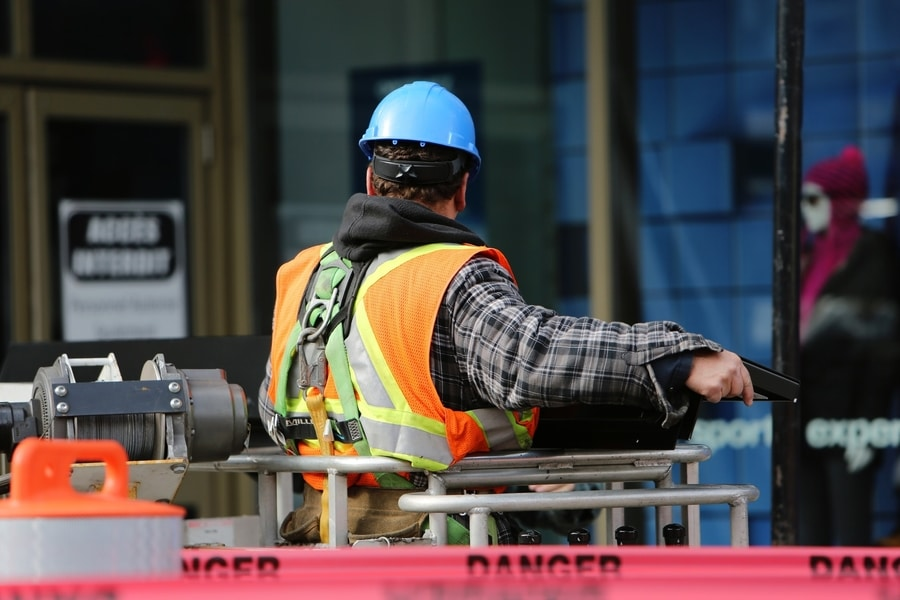 worker on lift with safety gear and equipment