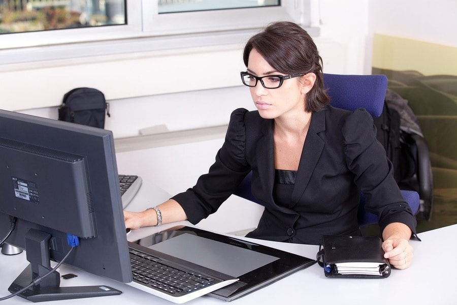 woman performing background checks on employees