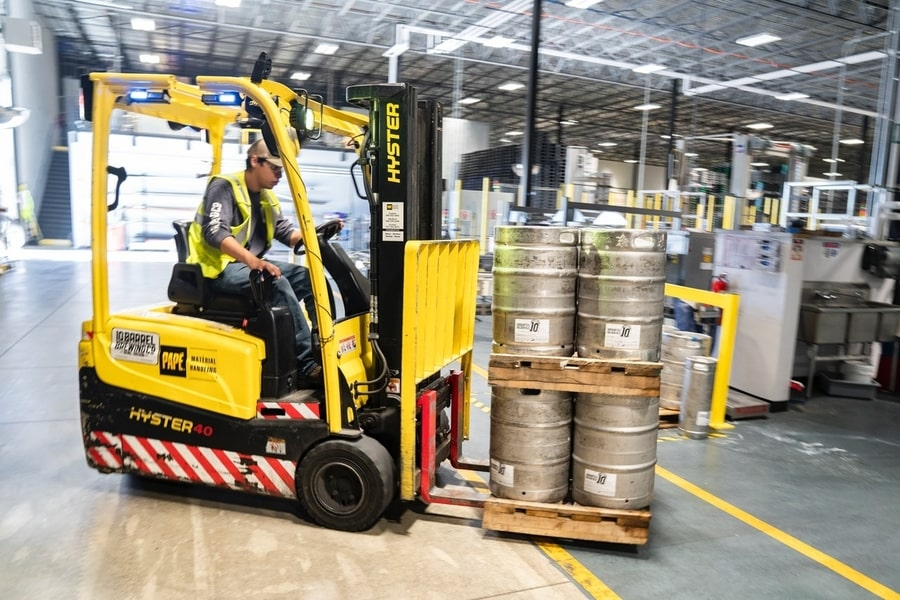 forklift moving palette of kegs workplace safety