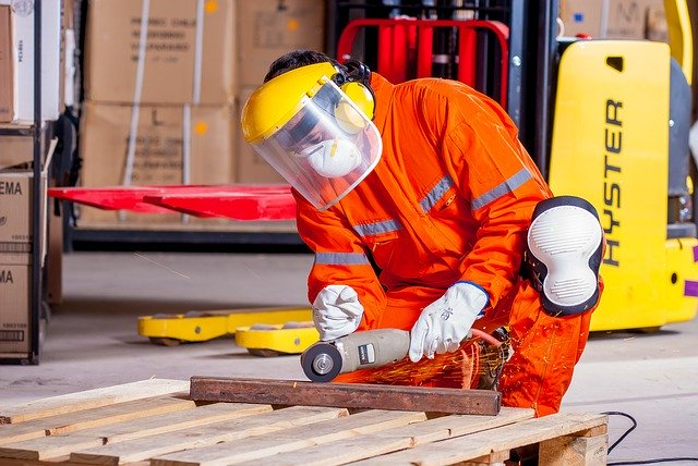 man working safely with protective equipment